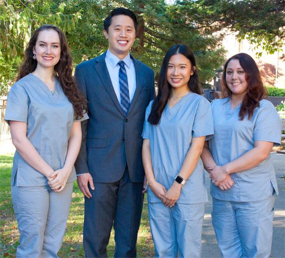 Podiatrist Dr. Jonathan Huey standing with his podiatry team