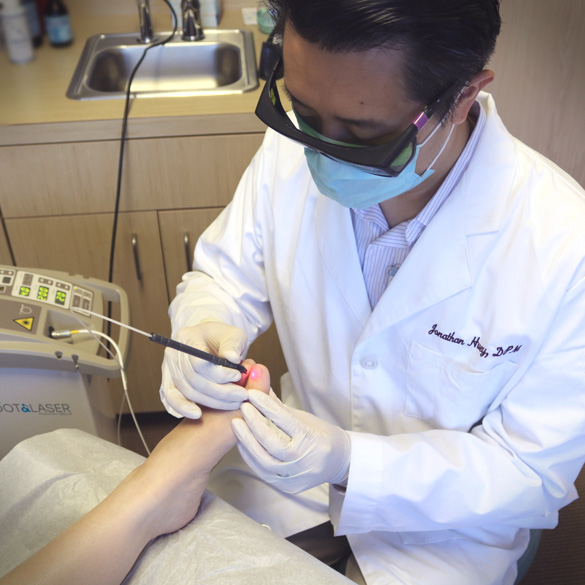 Dr. Jonathan Huey of Bay Area Foot and Laser Podiatry Group uses PinPointe™ FootLaser® to kill toenail fungus under the nail bed of a patient's toe